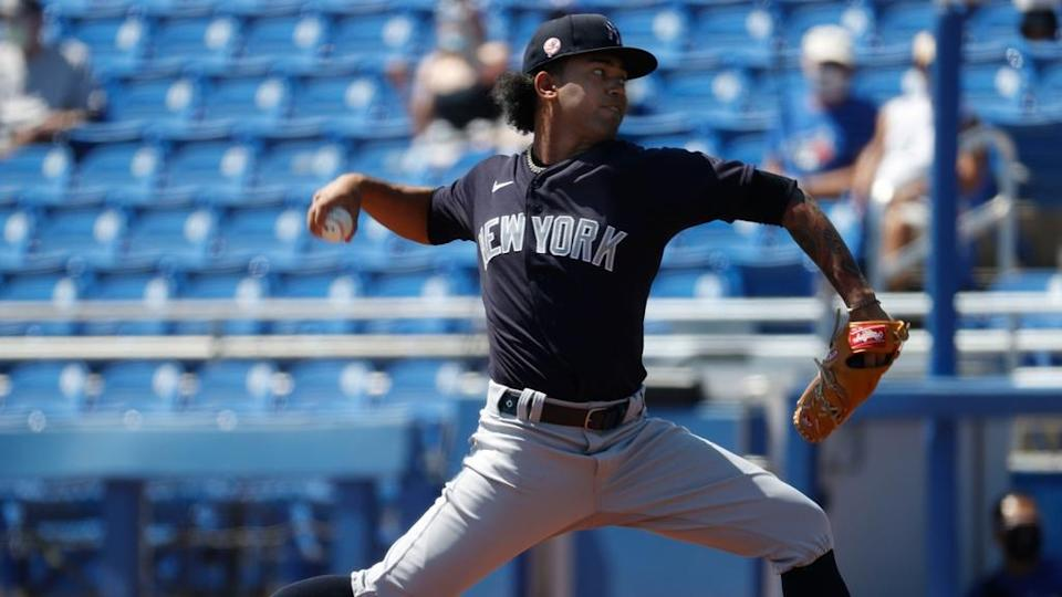 Deivi Garcia fires pitch vs. Blue Jays in spring training