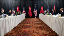 FILE - In this March 18, 2021, file photo Secretary of State Antony Blinken, second from right, joined by national security adviser Jake Sullivan, right, speaks while facing Chinese Communist Party foreign affairs chief Yang Jiechi, second from left, and China's State Councilor Wang Yi, left, at the opening session of US-China talks at the Captain Cook Hotel in Anchorage, Alaska. U.S. relations with its two biggest geo-political rivals are facing severe tests as President Joe Biden tries to assert himself as the world's foremost anti-authoritarian leader and distinguish himself from his predecessor. (Frederic J. Brown/Pool via AP, File)