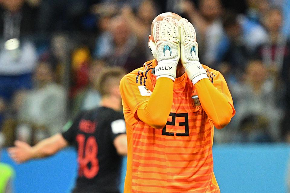 Head in hands: Willy Caballero's howler leaves Argentina close to an exit