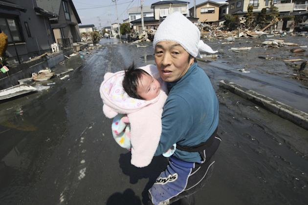 Upon hearing another tsunami warning, a father tries to flee for safety with his just reunited four-month-old baby girl.