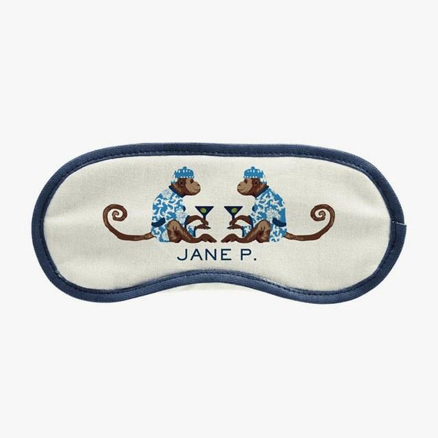 Parker Thatch eye mask in canvas with cocktail monkeys, $58<br />Buy it now