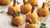 """<p>If you're looking for a fun appetizer to serve for Halloween, this visual masterpiece transforms a <a href=""""https://www.thedailymeal.com/cook/best-retro-recipes-gallery?referrer=yahoo&category=beauty_food&include_utm=1&utm_medium=referral&utm_source=yahoo&utm_campaign=feed"""" rel=""""nofollow noopener"""" target=""""_blank"""" data-ylk=""""slk:vintage recipe"""" class=""""link rapid-noclick-resp"""">vintage recipe</a> of cheese balls into miniature pumpkins with pretzel sticks and parsley leaves on top.</p> <p><a href=""""https://www.thedailymeal.com/recipe/cheddar-pumpkin-appetizer?referrer=yahoo&category=beauty_food&include_utm=1&utm_medium=referral&utm_source=yahoo&utm_campaign=feed"""" rel=""""nofollow noopener"""" target=""""_blank"""" data-ylk=""""slk:For the Cheddar Pumpkin Appetizers recipe, click here."""" class=""""link rapid-noclick-resp"""">For the Cheddar Pumpkin Appetizers recipe, click here.</a></p>"""
