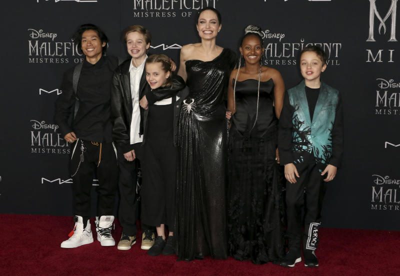 "Angelina Jolie, third right, and her children, from left, Maddox Jolie-Pitt, Shiloh Jolie-Pitt, Vivienne Jolie-Pitt, Zahara Jolie-Pitt and Knox Jolie-Pitt arrive at the world premiere of ""Maleficent: Mistress of Evil"" on Monday, Sept. 30, 2019, at the El Capitan Theatre in Los Angeles. (Photo by Willy Sanjuan/Invision/AP)"