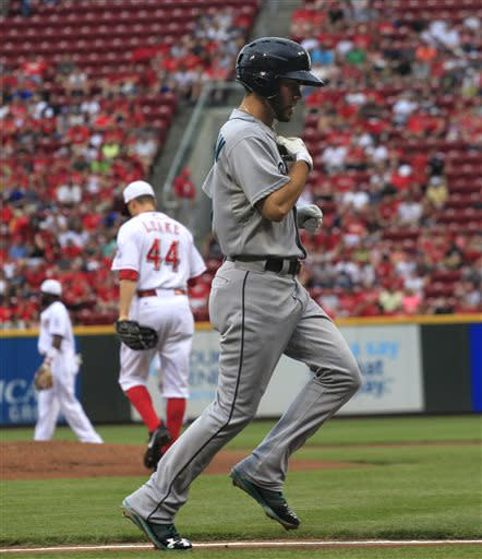 Seattle Mariners' Nick Franklin heads to home plate after hitting a two-run home run off Cincinnati Reds Mike Leake (44) in the first inning of their baseball game in Cincinnati, Friday July 5, 2013. (AP Photo/Tom Uhlman)