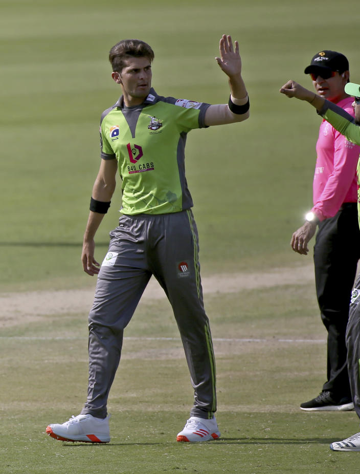 Lahore Qalandars' Shaheen Afridi celebrates after taking the wicket of Peshawar Zalmi's Sherfane Rutherford during a Pakistan Super League T20 cricket match between Peshawar Zalmi and Lahore Qalandars at the National Stadium, in Karachi, Pakistan, Sunday, Feb. 21 2021. (AP Photo/Fareed Khan)