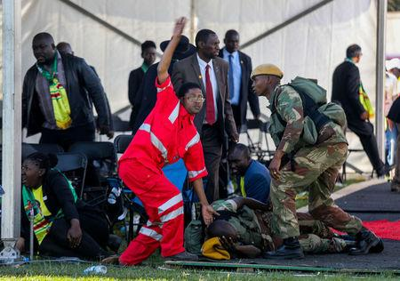 Medics attend to people injured in an explosion during a rally by Zimbabwean President Emmerson Mnangagwa in Bulawayo, Zimbabwe June 23, 2018. Tafadzwa Ufumeli/via REUTERS