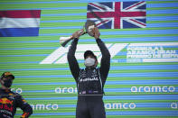 Mercedes driver Lewis Hamilton of Britain lifts his trophy on the podium after winning the Spanish Formula One Grand Prix at the Barcelona Catalunya racetrack in Montmelo, just outside Barcelona, Spain, Sunday, May 9, 2021. At left is second placed Red Bull driver Max Verstappen of the Netherlands. (AP Photo/Emilio Morenatti, Pool)
