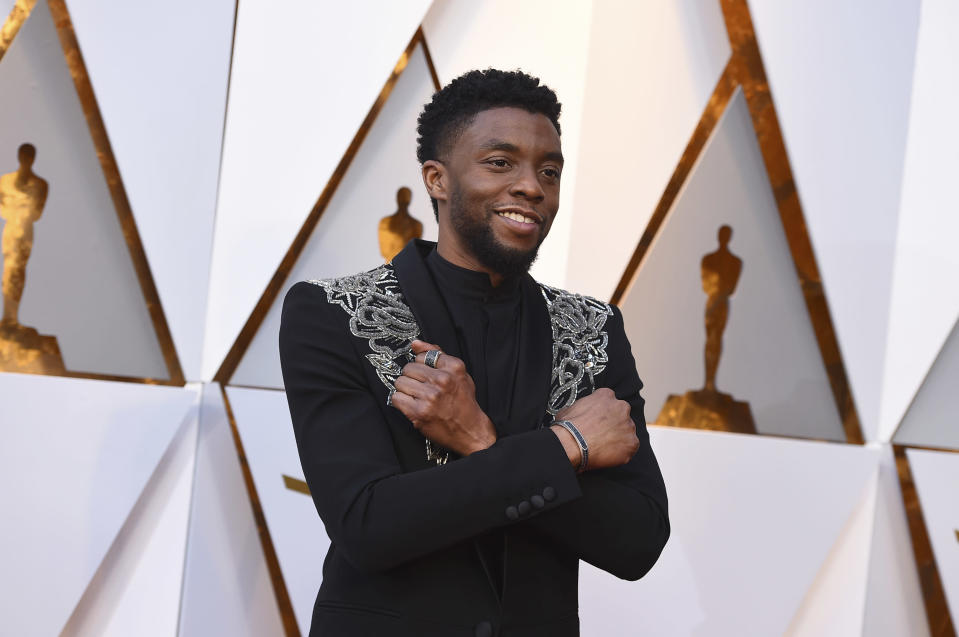 FILE - In this March 4, 2018, file photo Chadwick Boseman arrives at the Oscars at the Dolby Theatre in Los Angeles. The acclaimed actor is being posthumously honored as the namesake of Howard's newly re-established Chadwick A. Boseman College of Fine Arts. Boseman, who graduated in 2000 with a BFA in directing, died in August 2020 at age 43 of colon cancer, after an illness that was largely kept secret. He rose to prominence playing a succession of Black icons in biographical films: Jackie Robinson, singer James Brown and Thurgood Marshall. (Photo by Jordan Strauss/Invision/AP, File)