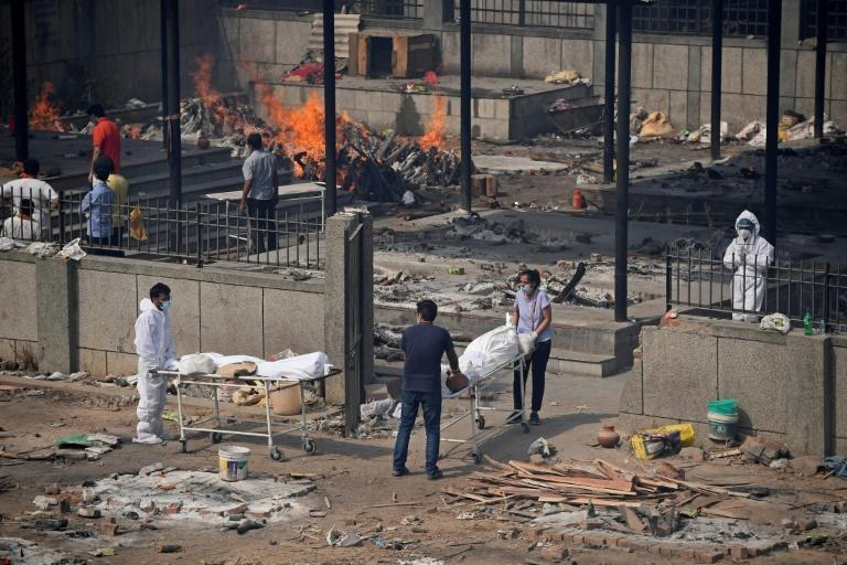 India's massive surge has seen impromptu cremation grounds spring up across New Delhi