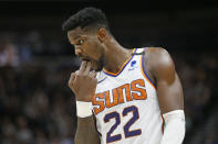 Phoenix Suns center Deandre Ayton (22) reacts to a foul in the first half during an NBA basketball game against the Utah Jazz, Monday, Feb. 24, 2020, in Salt Lake City. (AP Photo/Rick Bowmer)