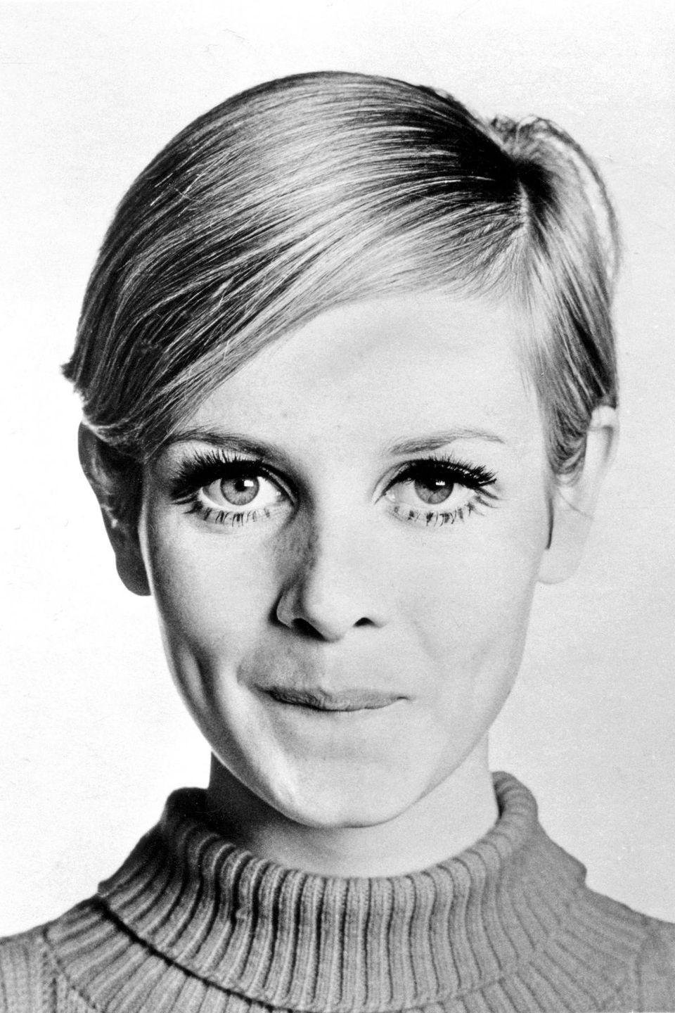 <p>Model Twiggy's timeless eyes wouldn't be complete without her deep-parted hair. </p>