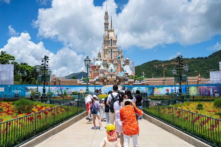 Visitors take photos of the Castle of Magical Dreams in Walt Disney Co.'s Disneyland Resort on June 18, 2020 in Hong Kong, China. / Credit: Getty Images