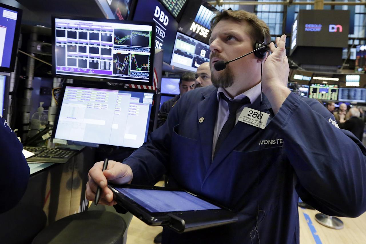 Trader Michael Milano works on the floor of the New York Stock Exchange, Tuesday, Jan. 17, 2017. Stocks are opening slightly lower on Wall Street, led by declines in banks and health care companies. (AP Photo/Richard Drew)