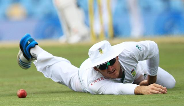 South Africa's captain Graeme Smith, looks on after dropping a catch on the third day of their their cricket Test match against Australia at Centurion Park in Pretoria, South Africa, Friday, Feb. 14, 2014. (AP Photo/ Themba Hadebe)