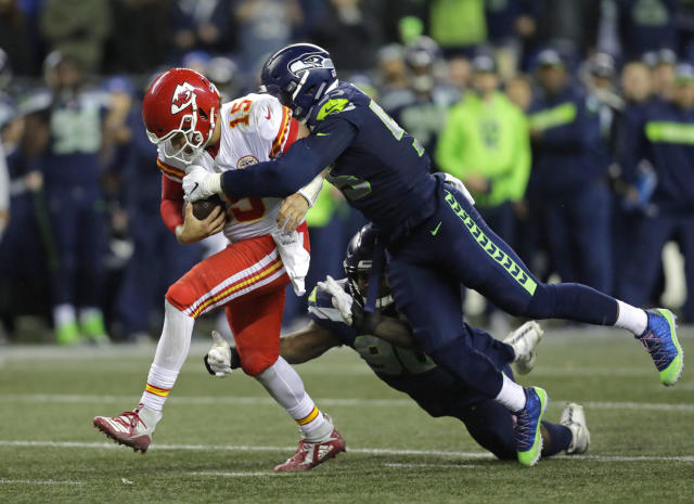 Kansas City Chiefs quarterback Patrick Mahomes (15) is tackled by Seattle Seahawks defensive end Frank Clark. (AP Photo/Stephen Brashear)