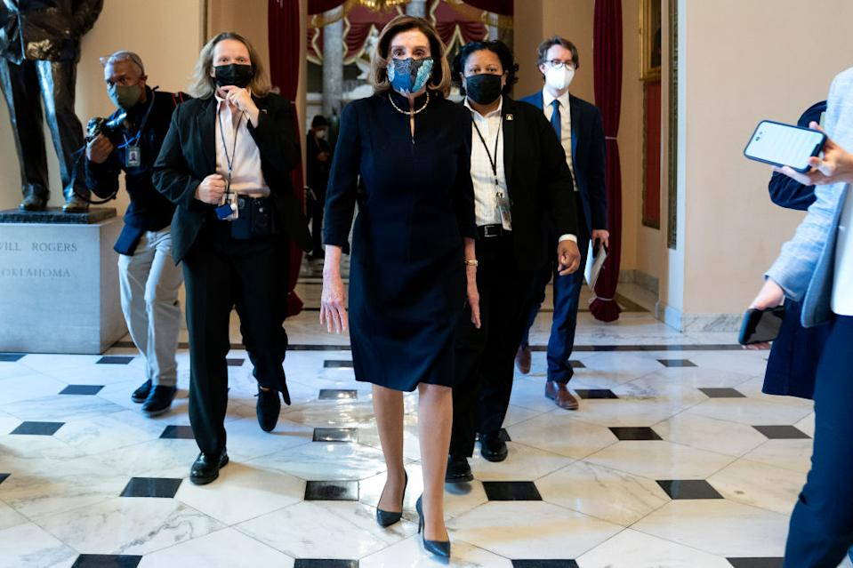 Nancy Pelosi arrived at the House of Representatives for impeachment proceedings against President Trump wearing the same dark suit she wore to his first impeachment trial in Dec. 2019.