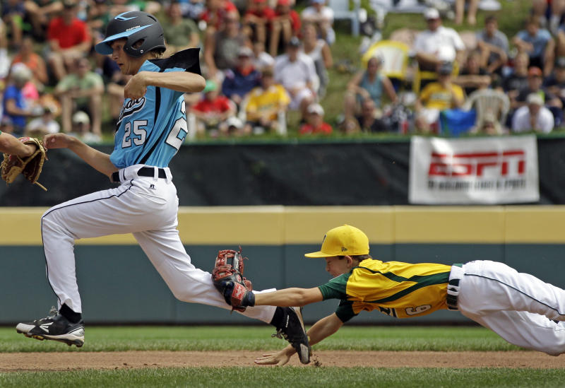 Petaluma, Calif., second baseman Porter Slate (6) dives to make the tag on Goodlettsville, Tenn.'s Brock Myers (25) to end a rundown between second and third during the second inning of a baseball game during Little League World Series pool play in South Williamsport, Pa., Sunday, Aug. 19, 2012. Goodlettsville won 9-6. (AP Photo/Gene J. Puskar)