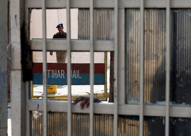 A policeman walks inside the Tihar Jail in New Delhi March 11, 2013.