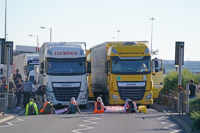 Protesters lie in front of lorries