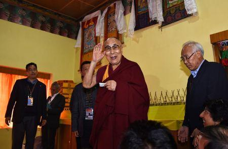 Tibetan spiritual leader Dalai Lama arrives to attend a press conference after delivering teachings at Yiga Choezin, in Tawang, in the northeastern state of Arunachal Pradesh, India April 8, 2017. REUTERS/Anuwar Hazarika