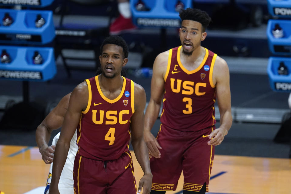 USC forward Evan Mobley (4) and Isaiah Mobley (3) watch against Kansas during the second half of a men's college basketball game in the second round of the NCAA tournament at Hinkle Fieldhouse in Indianapolis, Monday, March 22, 2021. (AP Photo/Paul Sancya)