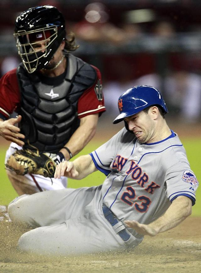 New York Mets' Mike Baxter (23) gets tagged out by Arizona Diamondbacks catcher Tuffy Gosewisch (54) in the third inning during a baseball game on Sunday, Aug. 11, 2013, in Phoenix. (AP Photo/Rick Scuteri)
