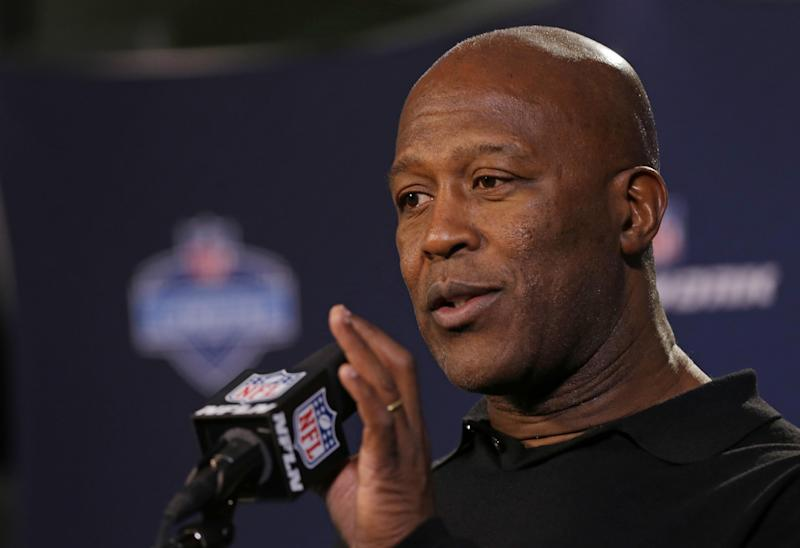 Tampa Bay Buccaneers head coach Lovie Smith answers a question during a news conference at the NFL football scouting combine in Indianapolis, Thursday, Feb. 20, 2014. (AP Photo/Michael Conroy)