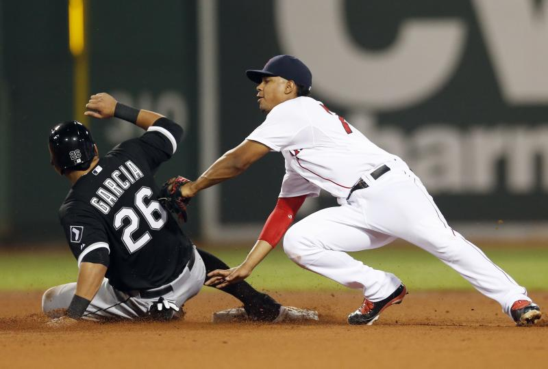Chicago White Sox's Avisail Garcia (26) steals second base as Boston Red Sox's Xander Bogaerts puts on a late tag in the fourth inning of a baseball game in Boston, Saturday, Aug. 31, 2013. (AP Photo/Michael Dwyer)