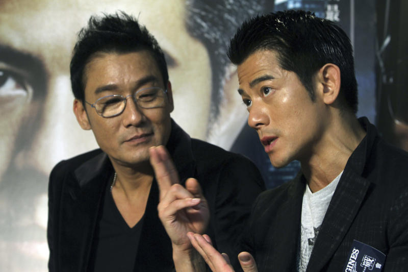 "In this photo taken on Monday, Nov. 12, 2012, Hong Kong actor Aaron Kwok, right, speaks while Tony Leung Ka Fai listens during an interview for their new film ""Cold War"" in Taipei, Taiwan. (AP Photo/Chiang Ying-ying)"