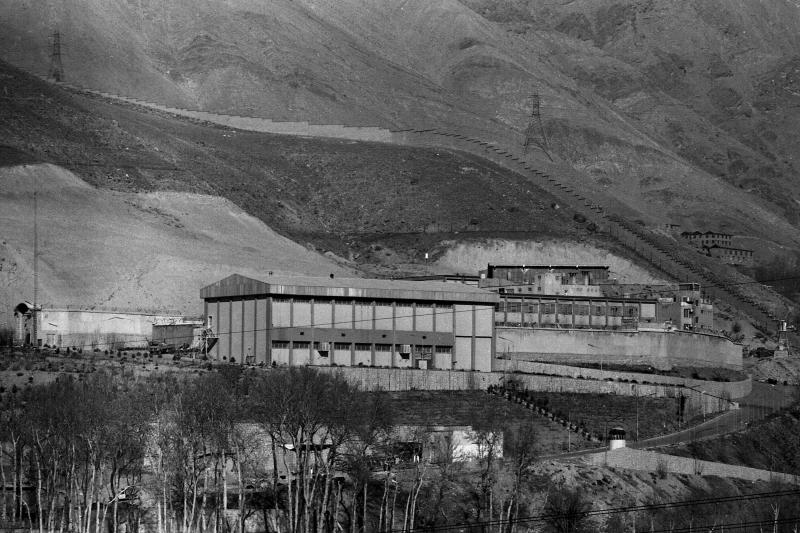 FILE - This January 1987, file photo shows Evin prison in Tehran, Iran. Two women who are dual British-Australian citizens and an Australian man have been detained in Iran, one of them sentenced to 10 years in prison, Australia's government and media said Wednesday, Sept. 11, 2019. Australia's Department of Foreign Affairs and Trade said it was providing consular assistance to the families of all three. The department said it could not comment further due to privacy obligations. (AP Photo, File)