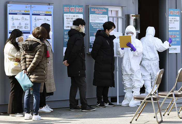 People suspected of having been infected with the coronavirus wait to receive tests at a medical center in Daegu, South Korea, Feb. 20, 2020. (Lee Moo-ryul/Newsis via AP)