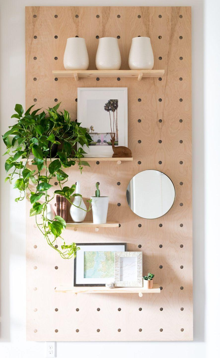 "<p>A pegboard looks good basically anywhere, and you can customize it as much as you want! Learn how to make one yourself from <a href=""https://vintagerevivals.com/2017/01/giant-pegboard-diy"" rel=""nofollow noopener"" target=""_blank"" data-ylk=""slk:Vintage Revivals"" class=""link rapid-noclick-resp"">Vintage Revivals</a>.</p>"