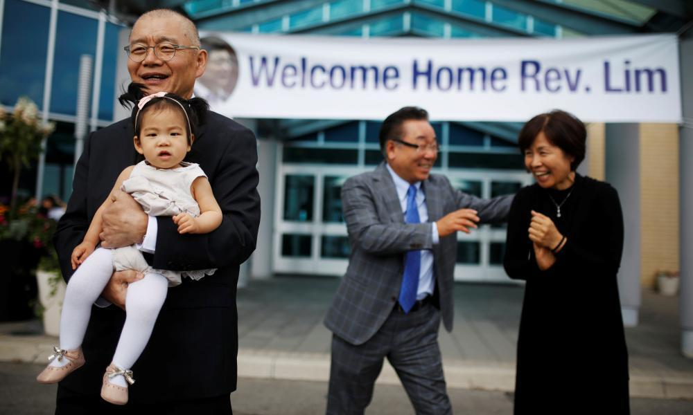 "<span class=""element-image__caption"">Pastor Hyeon Soo Lim, who returned to Canada from North Korea on 9 August, holds his granddaughter as he leaves the Light Presbyterian Church in Mississauga.</span> <span class=""element-image__credit"">Photograph: Mark Blinch/Reuters</span>"