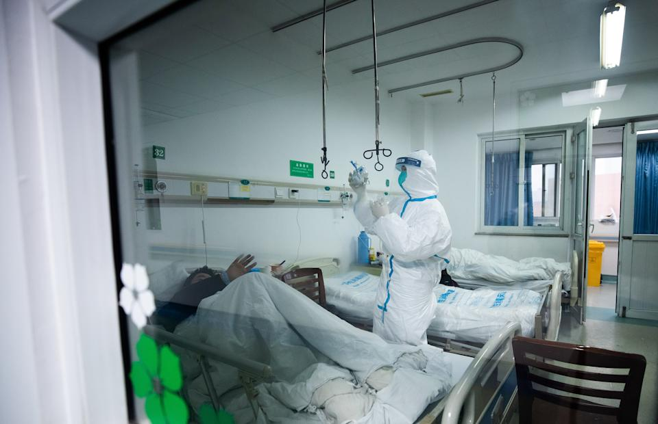 Medical staff work at Wuhan Jinyintan hospital, which specialises in the treatment of severe new coronavirus infected patients transferred from various hospitals in Wuhan City, Hubei Province, China.