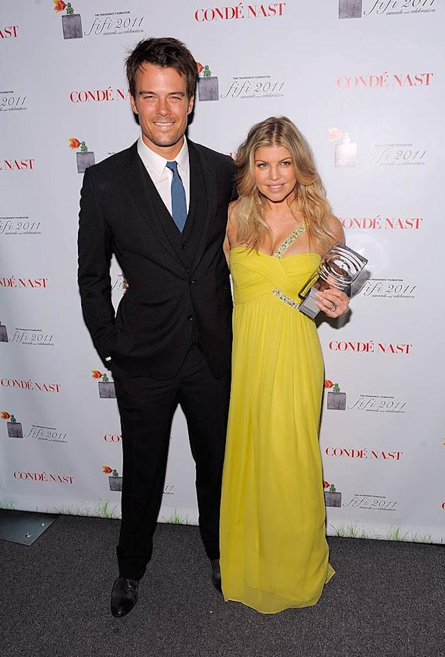 "Fergie rocked a yellow gown upon arriving with her actor hubby Josh Duhamel. The Black Eyed Peas lead singer walked off with the new fragrance celebrity of the year award for her perfume, Outspoken. Jemal Countess/<a href=""http://www.gettyimages.com/"" target=""new"">GettyImages.com</a> - May 25, 2011"