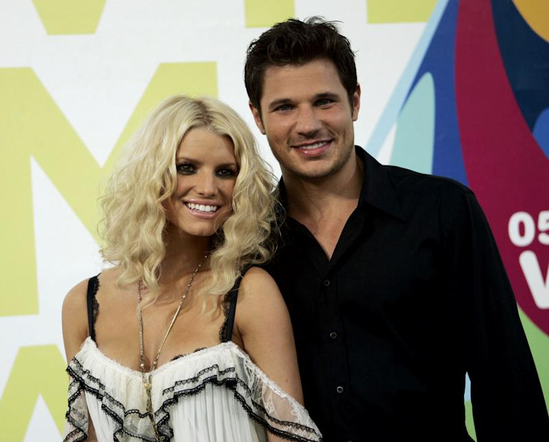 Singer Jessica Simpson and husband Nick Lachey arrive at the MTV Awards at the American Airlines Arena Sunday Aug. 28, 2005 in Miami, Fla. (AP Photo/Alan Diaz)