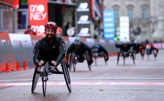 Canada's Brent Lakatos wins the wheelchair race