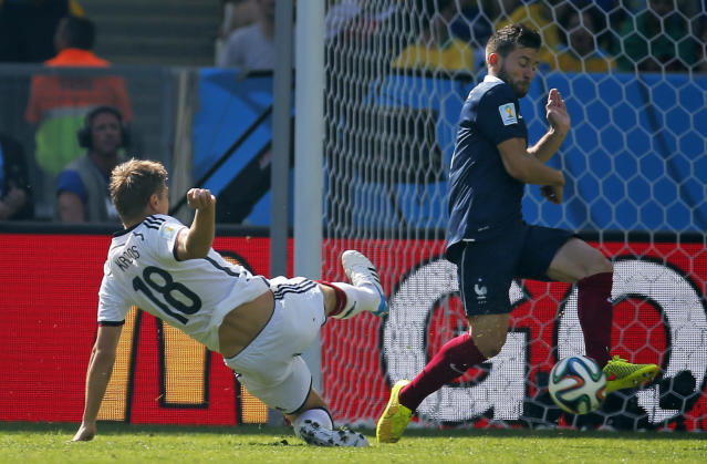 Germany's Toni Kroos, left, has a shot blocked by France's Yohan Cabaye during the World Cup quarterfinal soccer match between Germany and France at the Maracana Stadium in Rio de Janeiro, Brazil, Friday, July 4, 2014. (AP Photo/David Vincent)