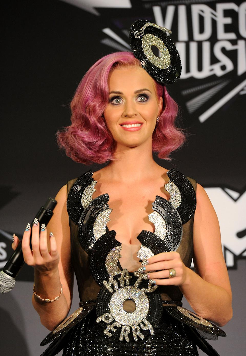 """LOS ANGELES, CA - AUGUST 28:  Singer Katy Perry, winner of the Video of the Year Award for 'Firework"""", Best Collaboration Award (featuring Kanye West) for """"E.T."""" and Best Special Effects in a Video for """"E.T."""" poses in the press room during the 2011 MTV Video Music Awards at Nokia Theatre L.A. LIVE on August 28, 2011 in Los Angeles, California.  (Photo by Jason Merritt/Getty Images)"""