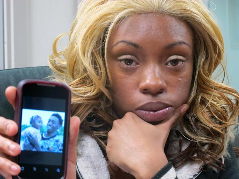 Sharday Rose, 24, poses in Milwaukee on Friday, March 29, 2013, with a photo of her boyfriend, Derek Williams, who died in 2011 in police custody while gasping for breath.A few hours earlier a prosecutor declined to charge the three police officers on the scene, citing a lack of evidence, and Rose said she was angry that the officers weren't being held accountable.  (AP Photo/Dinesh Ramde)