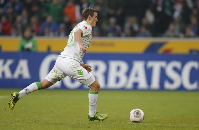 Moenchengladbach's striker Max Kruse scores from the penalty spot during the German first division Bundesliga football match Borussia Moenchengladbach vs FC Schalke 04 in Moenchengladbach, on December 7, 2013 (AFP Photo/Norbert Schmidt)