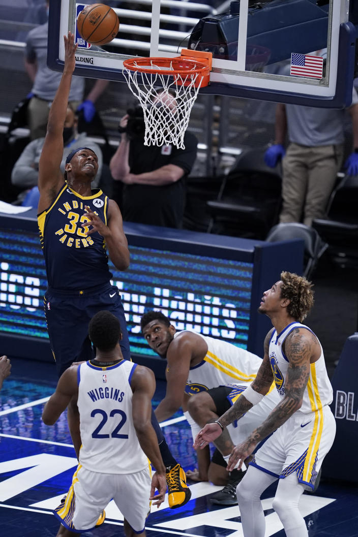 Indiana Pacers' Myles Turner (33) shoots during the second half of the team's NBA basketball game against the Golden State Warriors, Wednesday, Feb. 24, 2021, in Indianapolis. (AP Photo/Darron Cummings)
