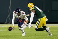 Chicago Bears' Mitchell Trubisky recovers his own fumble in front of Green Bay Packers' Preston Smith during the second half of an NFL football game Sunday, Nov. 29, 2020, in Green Bay, Wis. (AP Photo/Matt Ludtke)