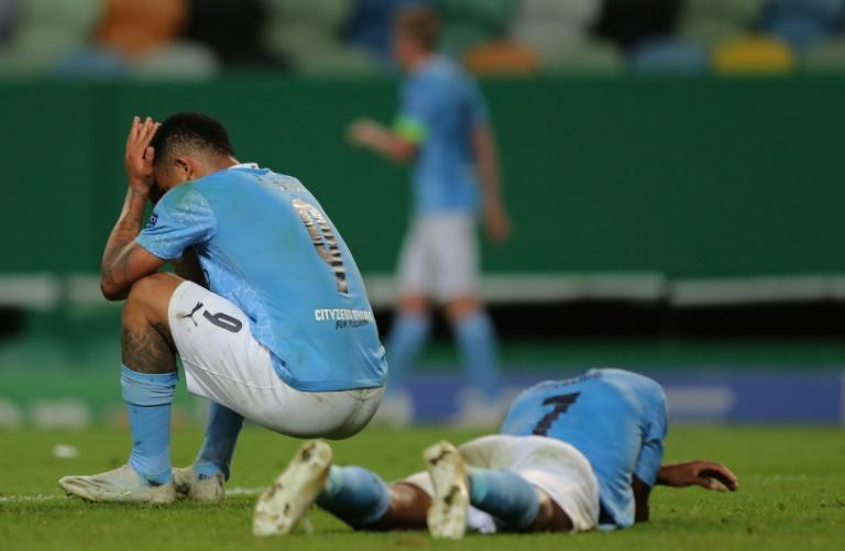Manchester City's Gabriel Jesus (left) and Raheem Sterling (right) react to losing to Lyon in last season's Champions League quarter-finals