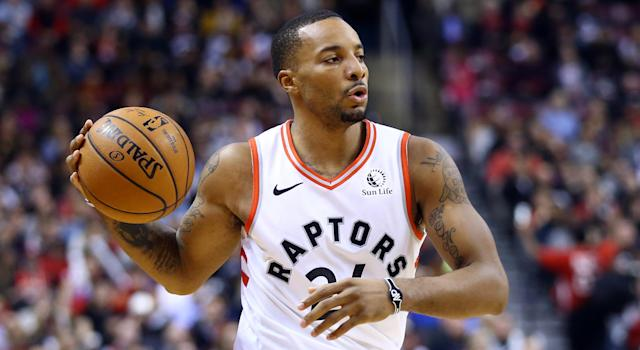 Norman Powell of the Toronto Raptors exited Wednesday night's contest in Detroit late in the fourth quarter after being crushed by a defender. (Photo by Vaughn Ridley/Getty Images)