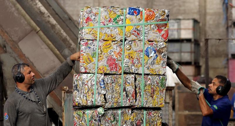 recycling recycled cans blocks warehouse workers teamwork Paulo Whitaker RTS28YI