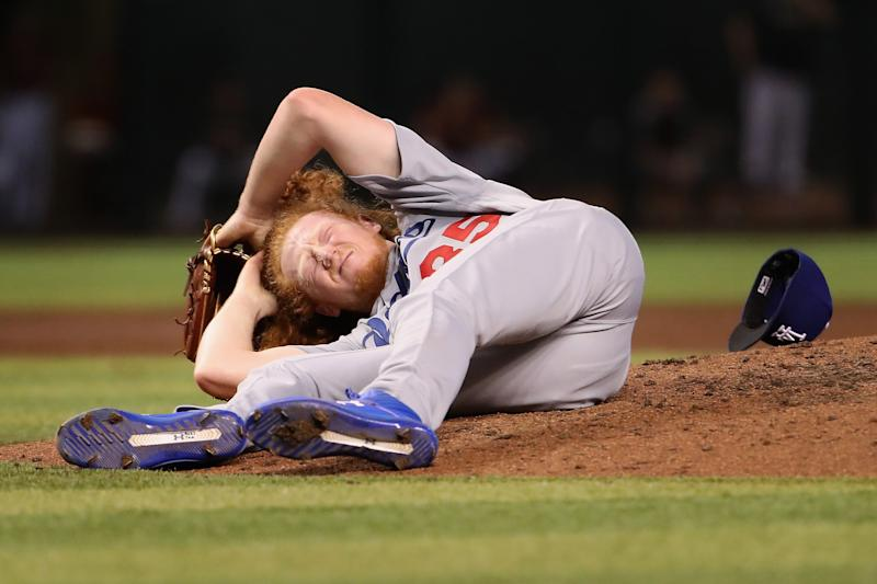 PHOENIX, ARIZONA - SEPTEMBER 01: Relief pitcher Dustin May #85 of the Los Angeles Dodgers reacts after being hit by a line drive during the fourth inning of the MLB game against the Arizona Diamondbacks at Chase Field on September 01, 2019 in Phoenix, Arizona. (Photo by Christian Petersen/Getty Images)