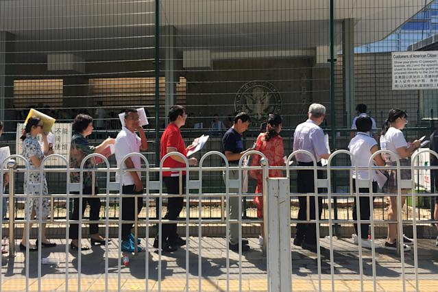 <p>People wait in line outside the U.S. Embassy in Beijing, China, July 26, 2018. (Photo: Jason Lee/Reuters) </p>