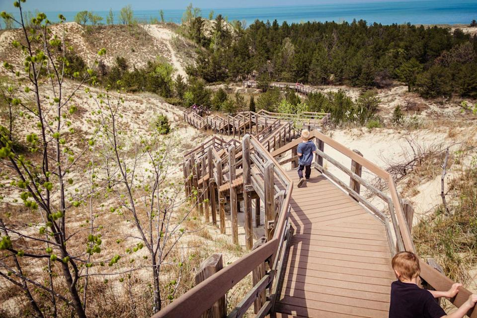 """<p><a href=""""https://www.nps.gov/indu/index.htm"""" rel=""""nofollow noopener"""" target=""""_blank"""" data-ylk=""""slk:Indiana Dunes National Park"""" class=""""link rapid-noclick-resp""""><strong>Indiana Dunes National Park</strong></a></p><p>Formerly a national lakeshore, this 15-mile stretch along Lake Michigan was upgraded in 2019 to national park status. There are many ways to get to the lake, but the wooden staircases that safely traverse the dunes are the most fun (and exhausting). </p>"""