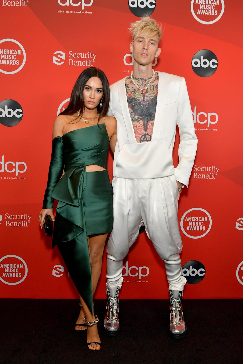 <p>Megan wore an Azzi & Osta look with Tasaki jewels, and Machine Gun Kelly wore a Balmain outfit with silver aviator boots from DSquared2.</p>